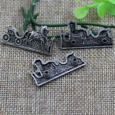 G086 Horse Drawn Cart Sew Spikes 35x18mm 100pcs/bag